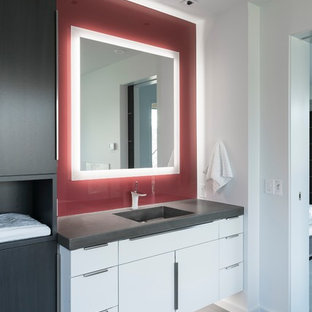 This is an example of a medium sized contemporary cloakroom in Salt Lake City with flat-panel cabinets, white cabinets, red walls, slate flooring, an integrated sink, engineered stone worktops, grey floors and grey worktops.