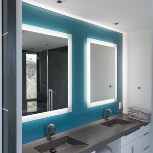 Inspiration for a medium sized contemporary cloakroom in Salt Lake City with flat-panel cabinets, white cabinets, blue tiles, blue walls, slate flooring, an integrated sink, engineered stone worktops and grey floors.