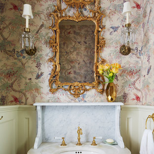 Powder room - victorian powder room idea in New York with multicolored walls and an undermount sink