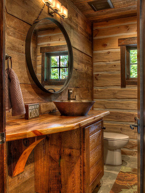 Rustic bathroom idea in Minneapolis with a vessel sink, medium tone wood  cabinets and wood