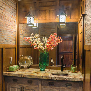 Photo of a medium sized classic cloakroom in New York with beige walls, a submerged sink, recessed-panel cabinets, medium wood cabinets, granite worktops, a one-piece toilet, brown tiles, slate flooring and matchstick tiles.
