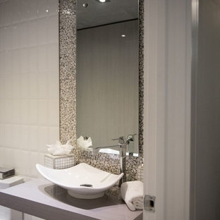 Design ideas for a medium sized traditional cloakroom in Miami with open cabinets, a two-piece toilet, grey tiles, mosaic tiles, white walls, slate flooring, a vessel sink, solid surface worktops and grey floors.