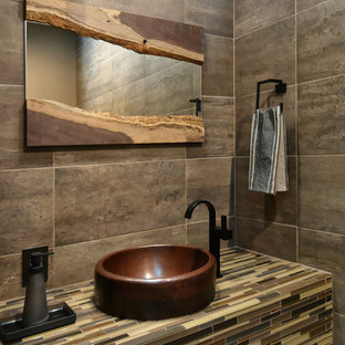 Inspiration for a medium sized contemporary cloakroom in Tampa with a vessel sink, tiled worktops, grey tiles, brown tiles and multi-coloured worktops.