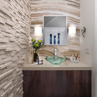 Inspiration for a small contemporary cloakroom in Los Angeles with flat-panel cabinets, dark wood cabinets, beige tiles, a vessel sink, grey floors and beige walls.