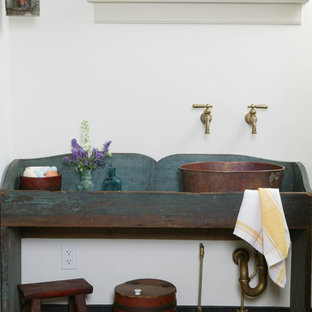 Mountain style powder room photo in Philadelphia with a vessel sink and blue cabinets