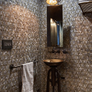Inspiration for a mid-sized industrial powder room remodel in Los Angeles with a vessel sink