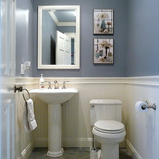 Design ideas for a small classic cloakroom in Boston with a pedestal sink, a two-piece toilet, blue walls, porcelain flooring and grey tiles.