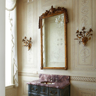 This is an example of a victorian cloakroom in Chicago with a submerged sink, freestanding cabinets, beige walls, distressed cabinets and purple worktops.