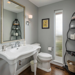 Example of a classic powder room design in Seattle with a console sink