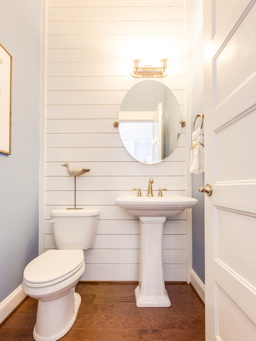 mid sized beach style medium tone wood floor and brown floor powder room idea in - Powder Room Pedestal Sink