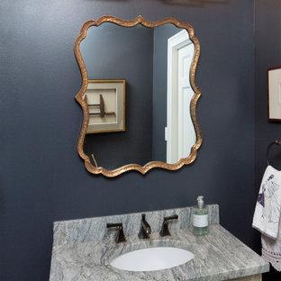 На фото: туалет среднего размера в стиле современная классика с фасадами с филенкой типа жалюзи, искусственно-состаренными фасадами, синими стенами, врезной раковиной и столешницей из искусственного кварца