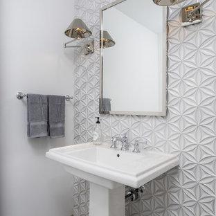 На фото: класса люкс туалеты среднего размера в современном стиле с белой плиткой, стеклянной плиткой, белыми стенами, полом из цементной плитки, раковиной с пьедесталом и бежевым полом