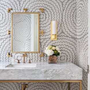 Large 1950s powder room photo in Houston with marble countertops, gray countertops, multicolored walls and an undermount sink
