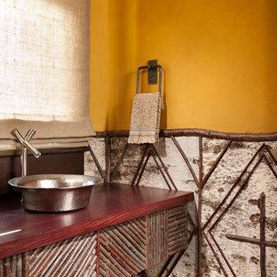 На фото: туалеты в стиле рустика с настольной раковиной, столешницей из дерева и красной столешницей