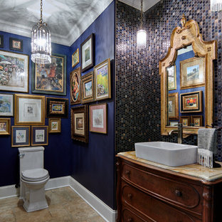 Idéer för att renovera ett mellanstort vintage flerfärgad flerfärgat toalett, med luckor med infälld panel, bruna skåp, en toalettstol med hel cisternkåpa, grå kakel, marmorkakel, blå väggar, terrazzogolv, ett fristående handfat, marmorbänkskiva och beiget golv