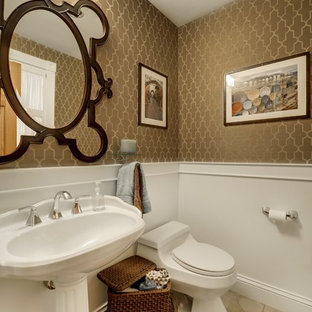 Inspiration for a traditional powder room in Minneapolis with a pedestal sink, a one-piece toilet and beige tile.