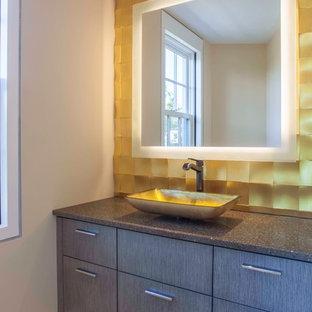На фото: туалет среднего размера в стиле модернизм с плоскими фасадами, серыми фасадами, желтой плиткой, стеклянной плиткой, бежевыми стенами, полом из керамогранита, настольной раковиной, столешницей из гранита и серой столешницей