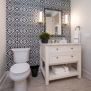 Photo of a coastal cloakroom in Grand Rapids with freestanding cabinets, white cabinets, multi-coloured walls, grey floors and white worktops.