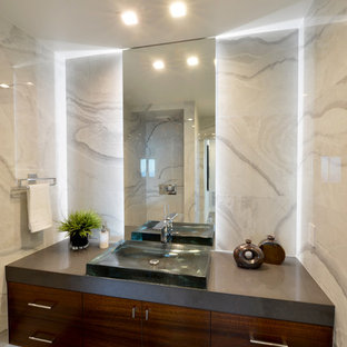 Medium sized modern cloakroom in San Diego with flat-panel cabinets, dark wood cabinets, multi-coloured tiles, stone tiles, multi-coloured walls, porcelain flooring, a built-in sink and engineered stone worktops.
