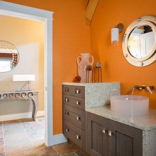 Ispirazione per un bagno di servizio contemporaneo di medie dimensioni con lavabo a bacinella, ante con riquadro incassato, ante in legno bruno, pareti arancioni, pavimento in gres porcellanato, top grigio, top alla veneziana e pavimento multicolore