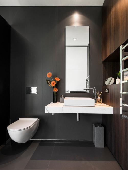 Black cloakroom design ideas renovations photos with dark wood cabinets - Cloakroom design ideas home ...