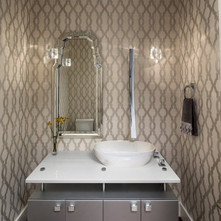 Trendy dark wood floor powder room photo in Boise with a vessel sink, flat-panel cabinets, gray cabinets, beige walls and white countertops