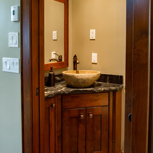 Inspiration for a small rural cloakroom in Vancouver with shaker cabinets, dark wood cabinets, brown walls, slate flooring, a vessel sink, granite worktops and brown floors.