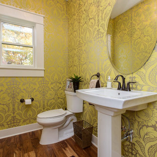 Transitional powder room in Cedar Rapids with a pedestal sink and a two-piece toilet.
