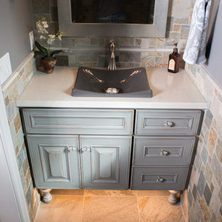 Design ideas for a medium sized rustic cloakroom in Other with raised-panel cabinets, a two-piece toilet, multi-coloured tiles, grey walls, slate flooring, a vessel sink, granite worktops, distressed cabinets and stone tiles.