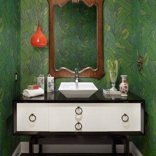 Inspiration pour un WC et toilettes design avec une vasque, un placard en trompe-l'oeil et des portes de placard blanches.
