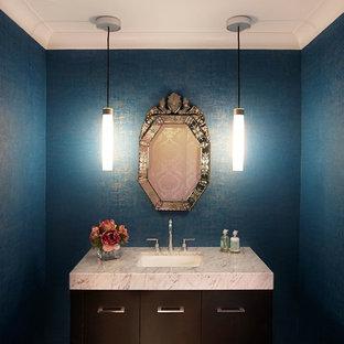 Идея дизайна: туалет среднего размера в стиле современная классика с врезной раковиной, плоскими фасадами, темными деревянными фасадами, мраморной столешницей и синими стенами