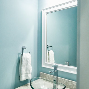 Example of a trendy powder room design in Other with white cabinets, blue walls, a vessel sink and gray countertops