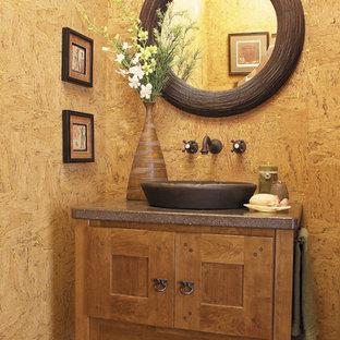 На фото: туалет среднего размера в стиле рустика с фасадами в стиле шейкер, фасадами цвета дерева среднего тона, коричневыми стенами, полом из керамической плитки, накладной раковиной и коричневым полом с