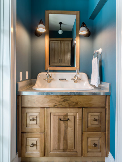 elegant powder room photo in tampa with a trough sink raised panel cabinets and