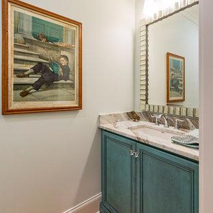 На фото: маленькие туалеты в стиле современная классика с врезной раковиной, фасадами с декоративным кантом, синими фасадами, мраморной столешницей, белыми стенами, светлым паркетным полом и бежевой столешницей