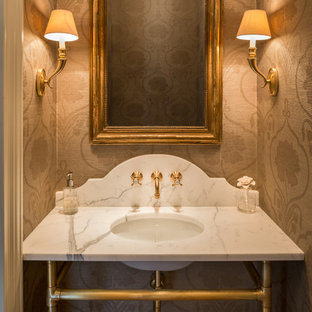 Large elegant powder room photo in Philadelphia with an undermount sink, marble countertops, beige walls and white countertops