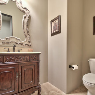 Cette image montre un WC et toilettes de taille moyenne avec un placard en trompe-l'oeil, des portes de placard en bois sombre, un WC séparé, un mur gris, un sol en travertin, un lavabo encastré, un plan de toilette en travertin, un sol beige et un plan de toilette beige.