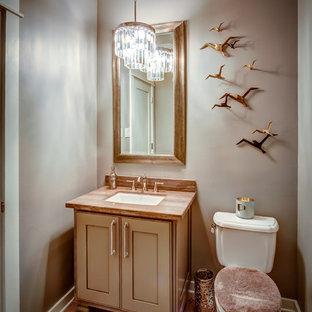 На фото: маленький туалет в стиле современная классика с фасадами с декоративным кантом, бежевыми фасадами, раздельным унитазом, серыми стенами, паркетным полом среднего тона и врезной раковиной с