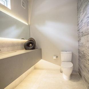 Idée de décoration pour un WC et toilettes minimaliste de taille moyenne avec un lavabo intégré, un plan de toilette en béton et un WC séparé.