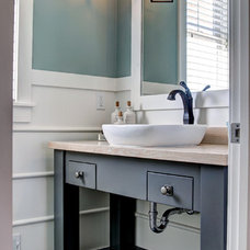 Traditional Powder Room by Dwellings
