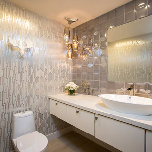 Design ideas for a contemporary cloakroom in Los Angeles with a vessel sink, flat-panel cabinets, white cabinets, multi-coloured walls, engineered stone worktops, grey tiles, porcelain tiles, porcelain flooring and white worktops.