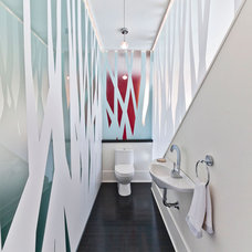Modern Powder Room by Kariouk Associates