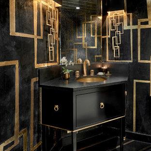 Cette photo montre un petit WC et toilettes tendance avec un placard en trompe-l'oeil, des portes de placard noires, un mur multicolore, un lavabo encastré, un sol multicolore et un plan de toilette noir.