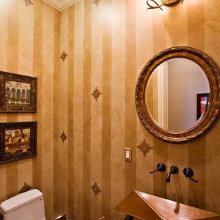 На фото: класса люкс маленькие туалеты в стиле фьюжн с фасадами островного типа, темными деревянными фасадами, унитазом-моноблоком, темным паркетным полом, столешницей из меди, настольной раковиной, желтой плиткой, желтыми стенами и коричневым полом