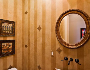 gold powder room with metal pedestal sink