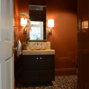 This is an example of a medium sized contemporary cloakroom in New Orleans with dark wood cabinets, mosaic tile flooring, a built-in sink, flat-panel cabinets, multi-coloured tiles, orange walls and onyx worktops.