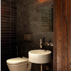 industrial powder room by Narofsky Architecture + ways2design