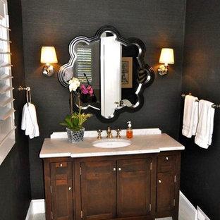 На фото: туалет среднего размера в классическом стиле с фасадами с декоративным кантом, бежевыми фасадами, черными стенами, полом из керамогранита, врезной раковиной, мраморной столешницей, белым полом и белой столешницей с