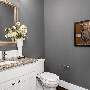 Идея дизайна: маленький туалет в стиле современная классика с фасадами в стиле шейкер, белыми фасадами, раздельным унитазом, белой плиткой, плиткой мозаикой, серыми стенами, темным паркетным полом, врезной раковиной, столешницей из гранита и серой столешницей