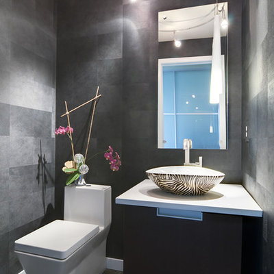 Inspiration for a small modern powder room remodel in Denver with a vessel sink and gray walls